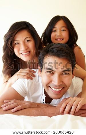 Mixed race Asian family - stock photo
