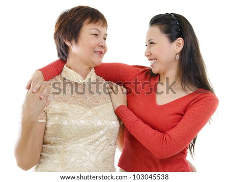 Mixed race Asian mother and daughter having conversation on white background - stock photo