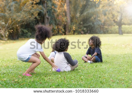 Mixed race children playing balls and having fun in autumn park .kid, child, school ,children,education , Summer concept .