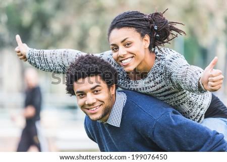 Mixed-Race Couple, Piggyback - stock photo