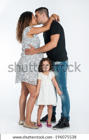 Mixed race couple. Pregnant mother, father and cute little girl.  - stock photo
