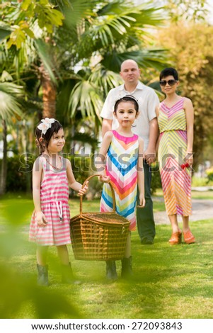 Mixed-race family spending weekend in the park