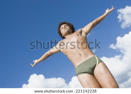 Mixed Race man wearing bathing suit