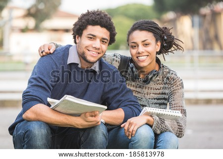Mixed-Race Student Couple Outdoor - stock photo