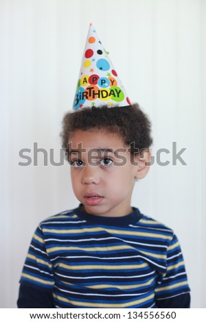 Mixed Race Toddler Boy With Birthday Hat - stock photo