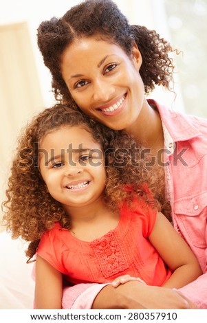 Mixed race woman and daughter at home - stock photo
