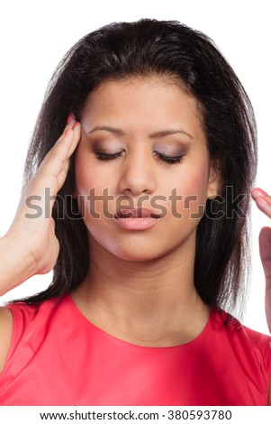 Mixed race woman suffering from headache migraine pain. Young girl isolated on white.