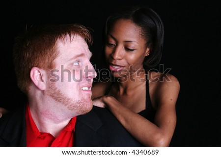 Mixed racial couple, close up, happy together and smiling at each other