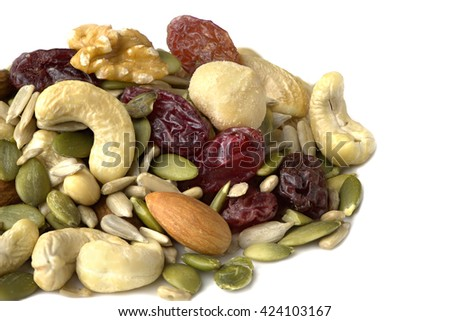 mixed raw nut and fruit isolated on white background
