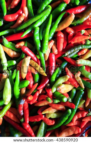 Mixed red and green chili pepper. Spicy red hot chili peppers. Chili peppers at local market display. - stock photo
