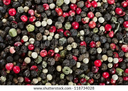 Mixed red, white and black peppercorns closeup. May used as background - stock photo