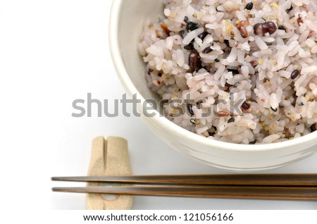 Mixed rice in japanese rice bowl (with Chopsticks and chopstick rest).