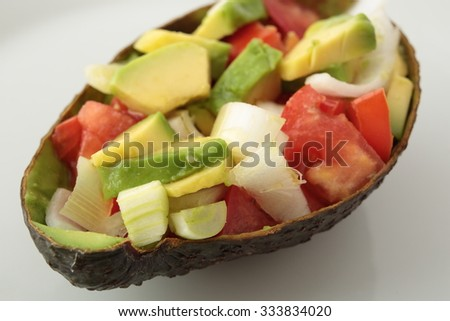 mixed salad cut into small pieces brought into the skin of an avocado