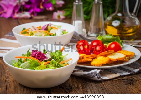 Mixed salad in white bowl. Selective focus. - stock photo
