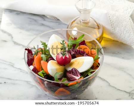 mixed salad with arugula carrot and egg - stock photo
