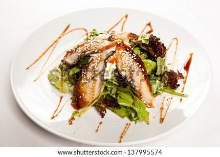 Mixed salad with eel - stock photo