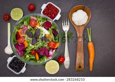 Mixed salad with salad ingredients - stock photo