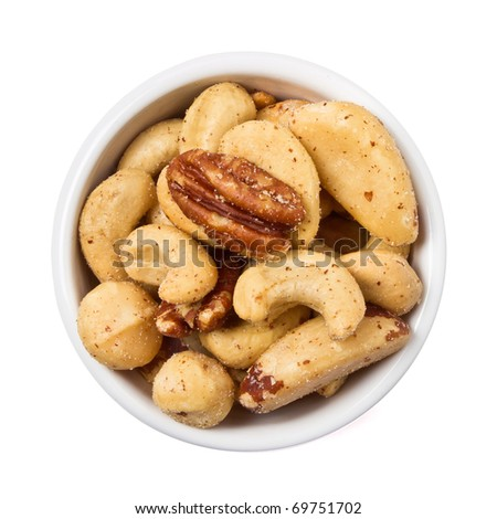Mixed Salted Nuts in bowl overhead view isolated on white. - stock photo