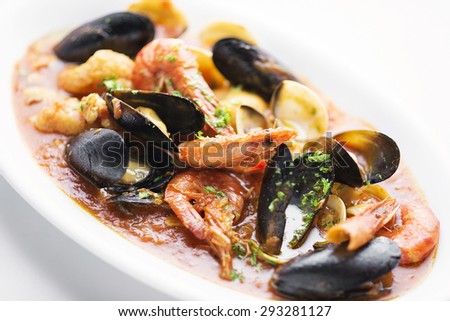 mixed seafood and fish in spicy tomato sauce stew