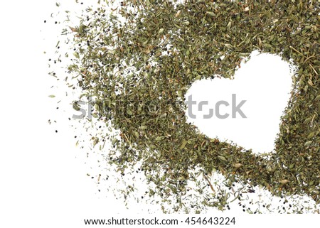 Mixed spices with heart silhouette on light background - stock photo