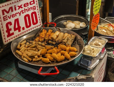 Mixed spring rolls and crab claws in Camden Town - stock photo