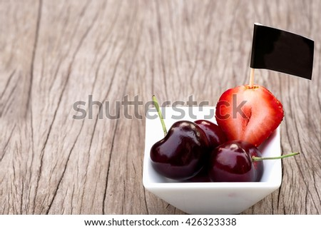 Mixed Strawberry Slice  and Nectarine in White Ceramic Bowl Decorate on Wood Background