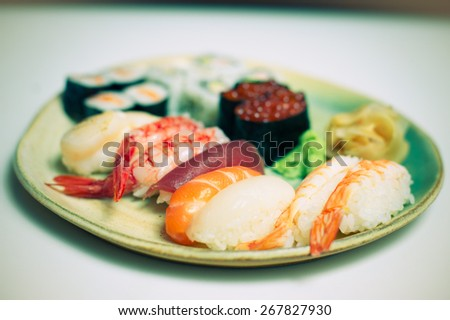 Mixed sushi plate on white background color effect - stock photo