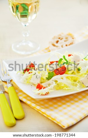 Mixed vegateble salad with the glass of white wine - stock photo