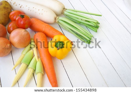 mixed vegetable on white wooden table - stock photo