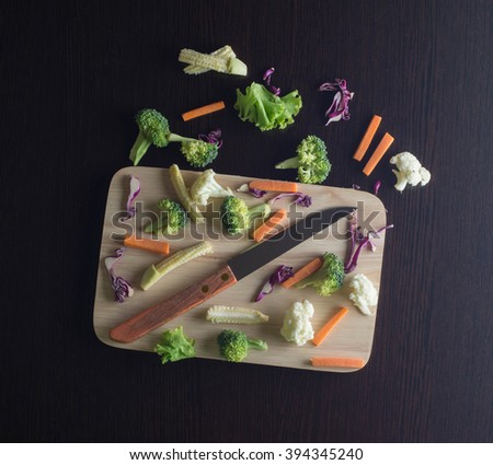 Mixed Vegetables have a carrots, broccoli, cauliflower, Purple cabbage, lettuce on cutting boards with knife - clean food concept - stock photo