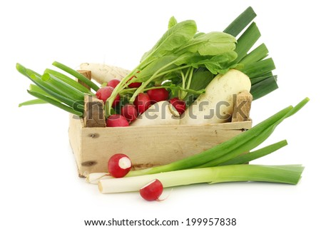mixed vegetables in a wooden crate on a white background - stock photo
