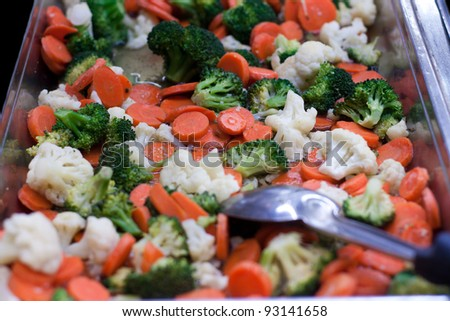 Mixed vegetables in pan with carrots and broccoli - stock photo