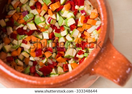 Mixed vegetables in terracotta pan - stock photo