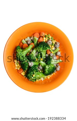 Mixed vegetables on a orange plate isolated on a white background - stock photo