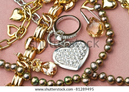 Mixed yellow and white  gold jewelry - stock photo