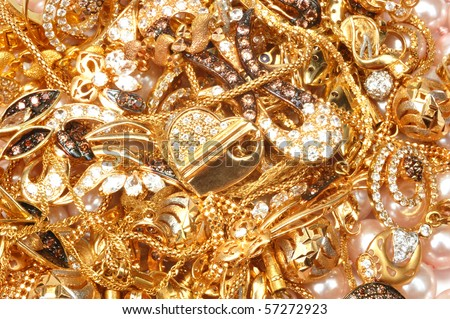 Mixed yellow gold jewelry - stock photo