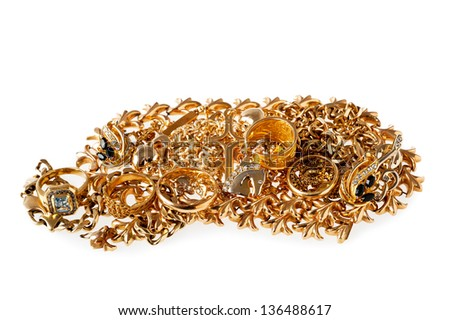 Mixed yellow gold jewelry on white background