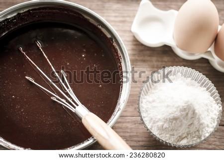mixed yolk eggs, flour and sugar prepare for baking cake or bake - stock photo