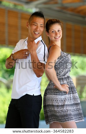Mixed young couple have fun in a park