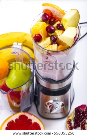 mixer and a variety of fruits to prepare a smoothie on a white background close-up.