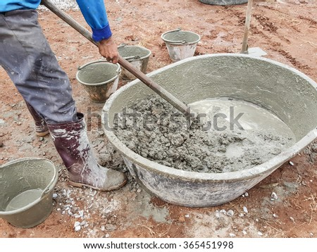 Mixer cements for building home,Man working