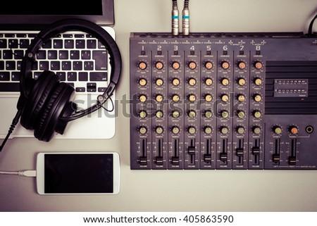Mixer, laptop and smart phone - stock photo