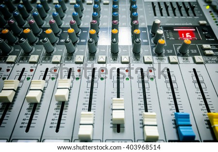 Mixer sound controllers buttons - stock photo
