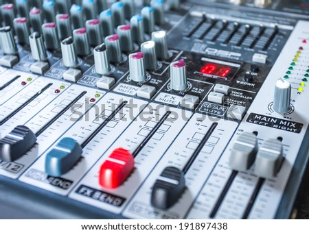 Mixer sound controllers with dust. - stock photo