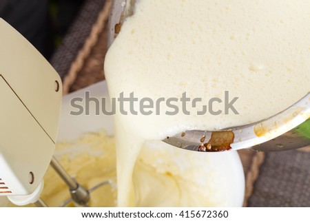Mixing cake dough in saucepan with butter. Macro. Photo can be used as a whole background. - stock photo