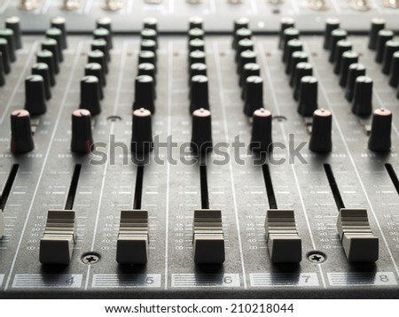 Mixing desk, back lit,  , for music and sound , entertainment themes - stock photo