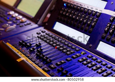 mixing desk with regulators, lamps, lights and different keys