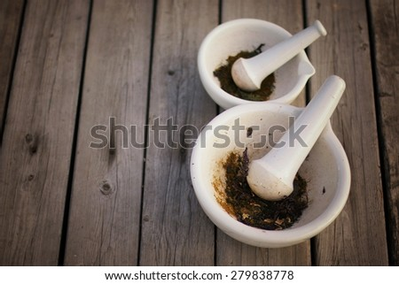mixing grinding spices in a mortar - stock photo