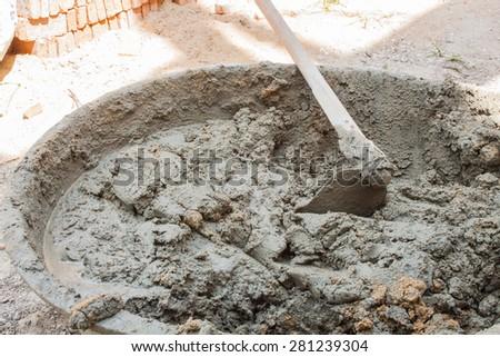 mixing motar cement for masonry  : masonry brick wall work detail - stock photo