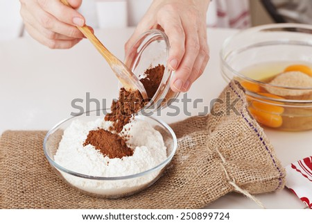 mixing the flour with cocoa - stock photo